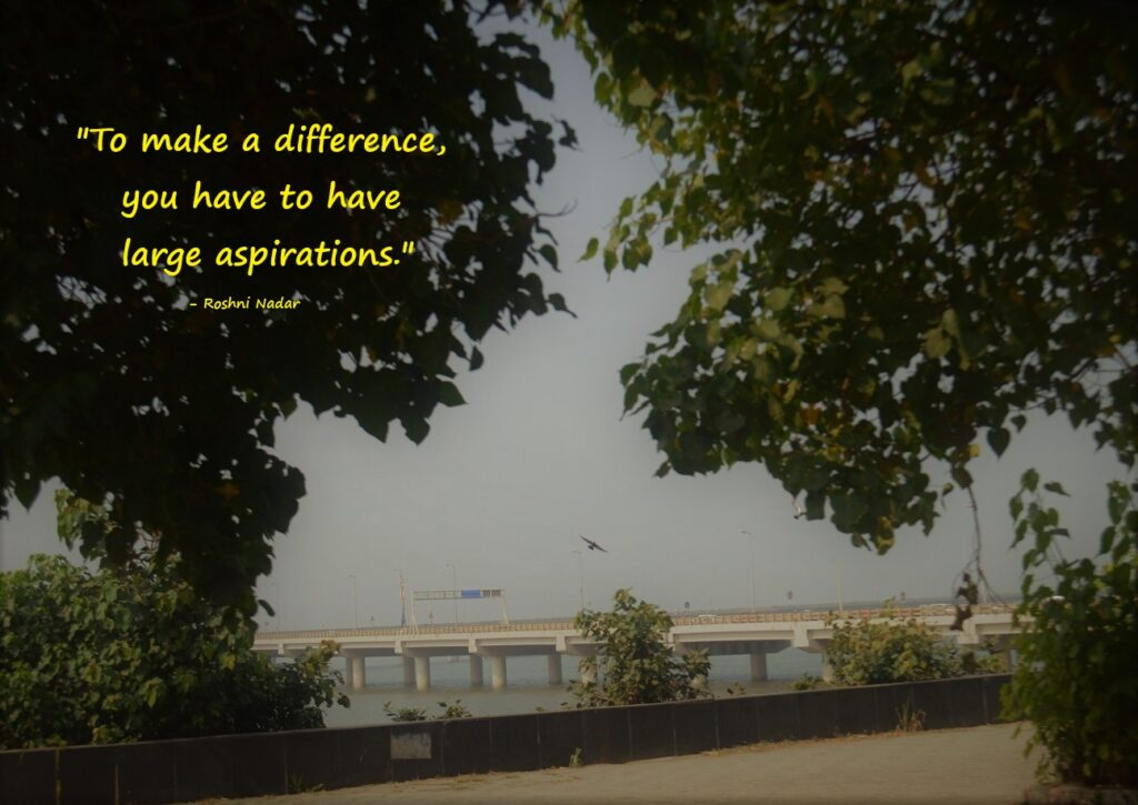 quote by Roshni Nadar on pic of sea-link and a bird flying near trees