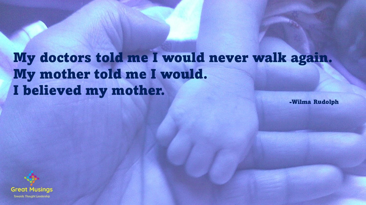 Motherly Quote on image of parent child hands.